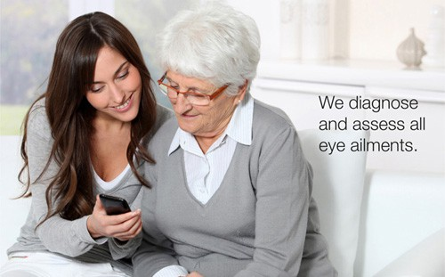 young woman showing older woman with glasses something on a smartphone